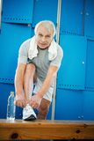 Senior man in a fitness club Stock Photo