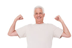 Senior man flexing his arms Royalty Free Stock Images