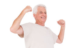 Senior man flexing his arms Stock Image