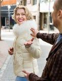 Senior man flirting with smiling blonde woman Stock Photos