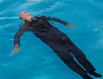 Senior man floating on back in water Stock Photography