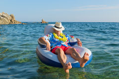 Senior man floating in sea Royalty Free Stock Photography