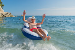 Senior man floating in sea Royalty Free Stock Photos