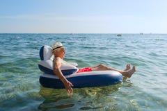 Senior man floating in sea Royalty Free Stock Image