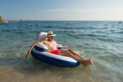 Senior man floating in sea Royalty Free Stock Images