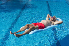 Senior man floating on water Royalty Free Stock Image