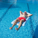 Senior man floating on water Stock Photo