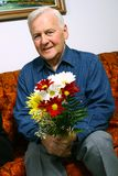 Senior man with flowers Royalty Free Stock Images