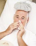 Senior Man with Flu. Senior man home sick with the flu Stock Image