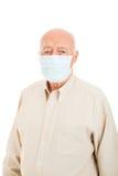 Senior Man - Flu Protection. Senior man wearing a surgical mask to protect against flu epidemic.  Isolated on white Stock Image