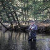 Senior man fly fishing Stock Photography