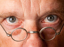 Senior man with focus on glasses Royalty Free Stock Photo