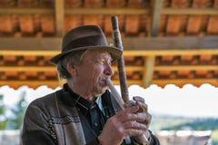 Folk musician plays music. Yablunytsia, resort Bukovel, Ukraine. royalty free stock photos