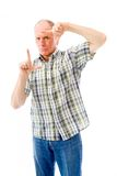 Senior man framing face with fingers Royalty Free Stock Image