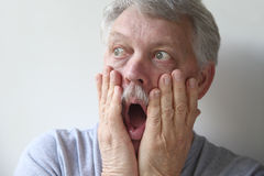 Senior man is frightened Stock Photography