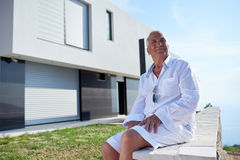 Senior man in front of modern home Royalty Free Stock Photo