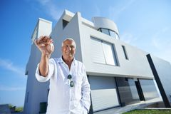 Senior man in front of modern home Stock Photos