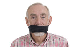 Senior man with gag over mouth Stock Image