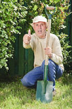 Senior man in garden with thumb up Stock Photography