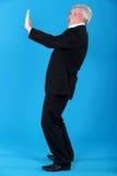 Senior man gesturing Stock Photo