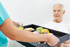 Senior man getting breakfast in bed Stock Photos