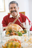 Senior Man Getting Ready To Carve The Turkey Royalty Free Stock Photos
