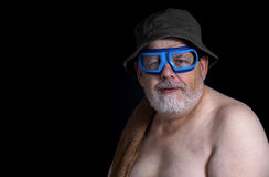 Senior man getting ready to have a bath Royalty Free Stock Photography