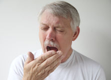 Senior man getting ready to yawn or sneeze Stock Images