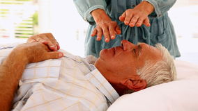 Senior man getting reiki therapy. In therapy room stock video footage
