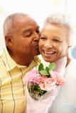 Senior man giving flowers to wife. Senior men giving flowers to wife Stock Photos