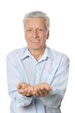 Senior man giving Royalty Free Stock Photos