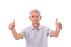 Senior man giving two thumbs up Royalty Free Stock Images