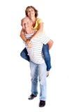 Senior man giving woman piggyback ride Royalty Free Stock Image
