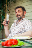 Senior man with a glass of beer Royalty Free Stock Images