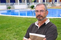 Senior man glasses relax on vacation garden pool Stock Image