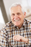 Senior Man With Glasses Relaxing In Chair At Home Royalty Free Stock Images