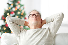 Senior man in glasses relaxing on sofa Royalty Free Stock Photo