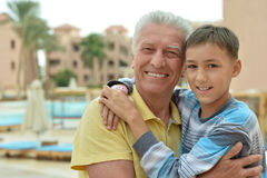 Senior man with grandchild at vacation resort Stock Photos