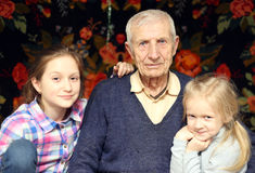 Senior man with  granddaughters Stock Images