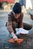 Senior man grilling sausages Stock Photography