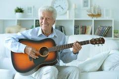 Senior man with guitar Stock Photo