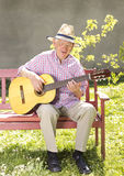 Senior man with guitar Stock Images