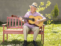 Senior man with guitar Royalty Free Stock Image