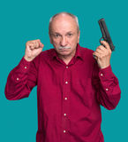 Senior man with a gun Stock Image