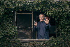 Senior man with a gun protecting property Royalty Free Stock Images