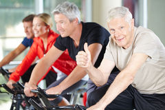 Senior man in gym holding thumbs up Royalty Free Stock Photo