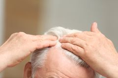 Senior man with hair loss problem indoors. Closeup royalty free stock images
