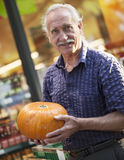 Senior man and Halloween Shopping Royalty Free Stock Image
