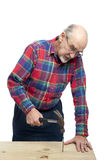 Senior man with hammer Stock Photo