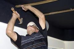 Senior man hammering Royalty Free Stock Photography